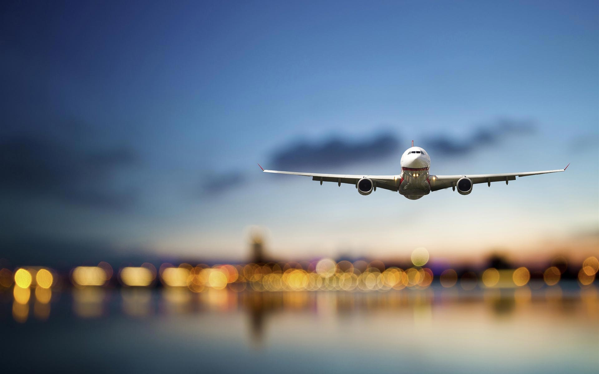 Airplane approching runway as background image