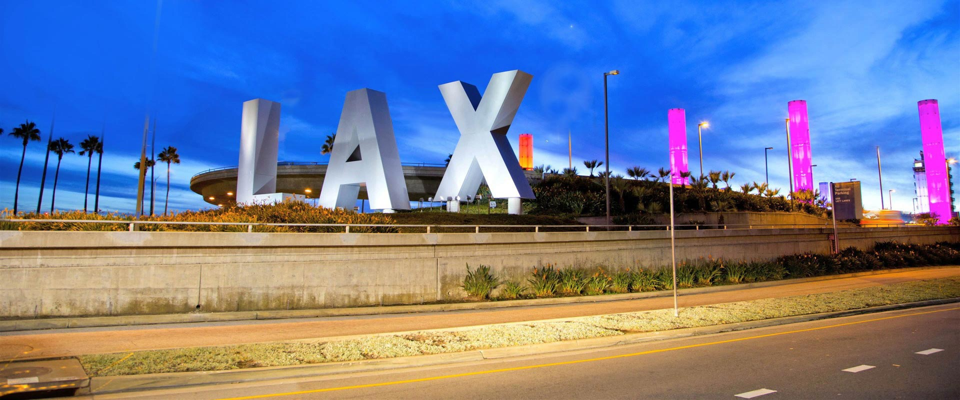 Background Image LAX Sign in All Capital Letter with Pylons